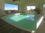 Proposer cette annonce : LEHON - vue panoramique sur Dinan, superbe contemporaine avec piscine intérieure