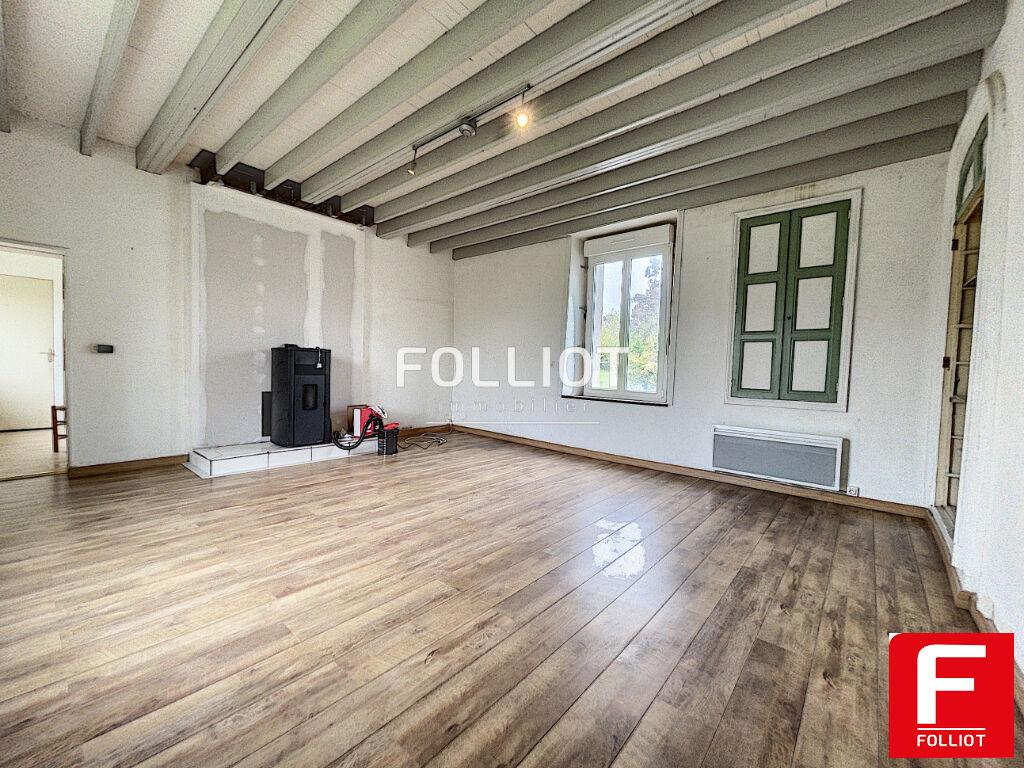 A vendre à la Chapelle du Fest, maison mitoyenne de  5 PP sur terrain de 1411 m²