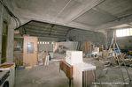 Immeuble comprenant 3 appartements et un  grand garage de 180 m² environ