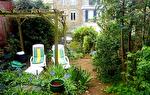 Maison de ville en pierre avec jardin